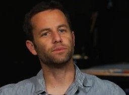 Kirk Cameron staring pensively at monuments