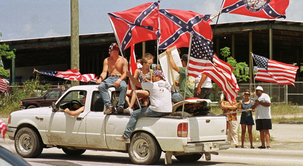 PROTESTERS SHOW CONFEDERATE AND US FLAGS AT PRO RENO RALLY.